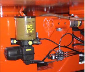 centralsmøringsanlæg monteret på landbrugsmaskine